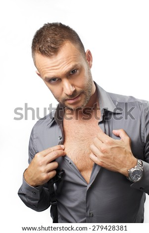man show his is breast on white background  - stock photo