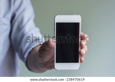 man show his smart phone, smart phone in the hand with thumb up - stock photo