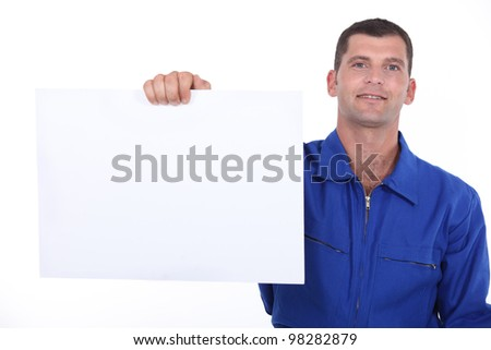 man showing a piece of paper - stock photo