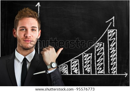 Man showing a positive diagram on a blackboard - stock photo