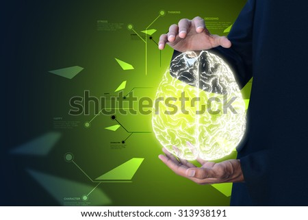 Man showing digital brain in color background - stock photo