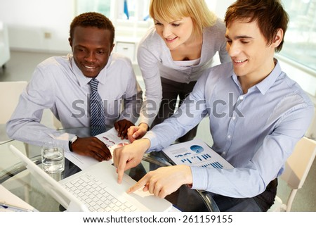 Man showing files to his colleagues - stock photo