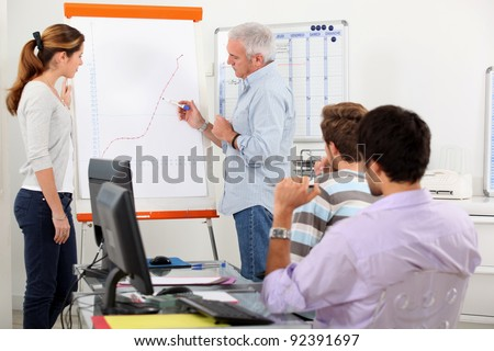 Man showing growth on a presentation board - stock photo