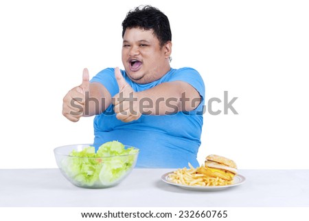 Man showing healthy and unhealthy food, isolated on white background - stock photo