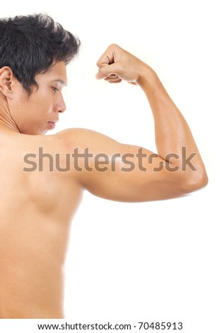 man showing his arm muscle - stock photo