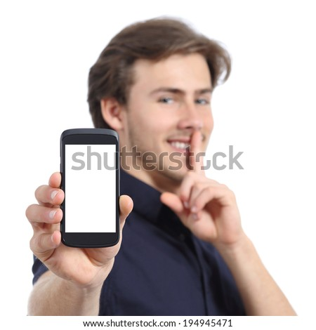 Man showing mobile phone screen and asking for silence isolated on a white background - stock photo