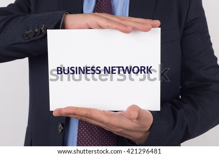 Man showing paper with BUSINESS NETWORK text - stock photo