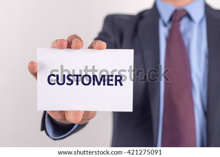 Man showing paper with CUSTOMER text - stock photo