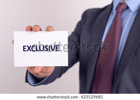 Man showing paper with EXCLUSIVE text