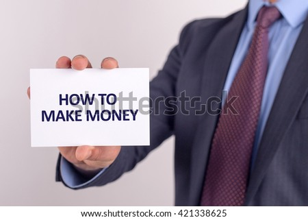 Man showing paper with HOW TO MAKE MONEY text