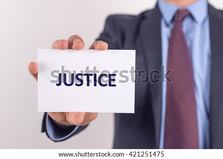 Man showing paper with JUSTICE text