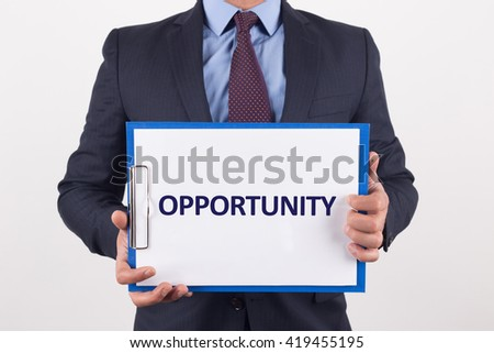 Man showing paper with OPPORTUNITY text - stock photo