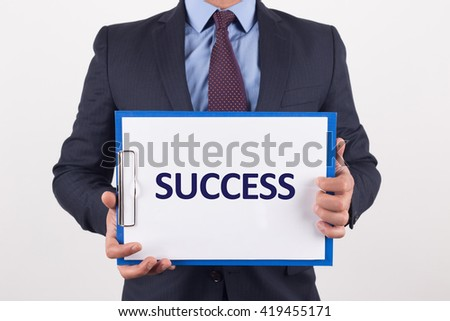 Man showing paper with SUCCESS text - stock photo