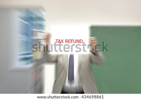 Man showing paper with TAX REFUND text blurred - stock photo