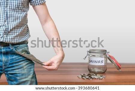 Man showing pocket as no money symbol and jar with coins. - stock photo