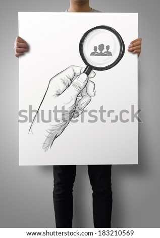 man showing poster of drawing of hand holding magnifier glass looking for employee as concept - stock photo