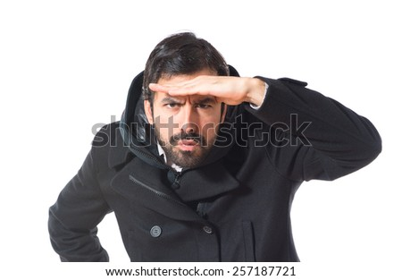 Man showing something over white background