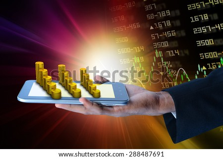 Man showing  tablet computer with financial stock market data  - stock photo