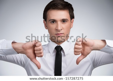 Man showing thumbs doown - stock photo