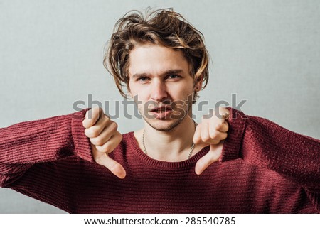 man showing thumbs down - stock photo