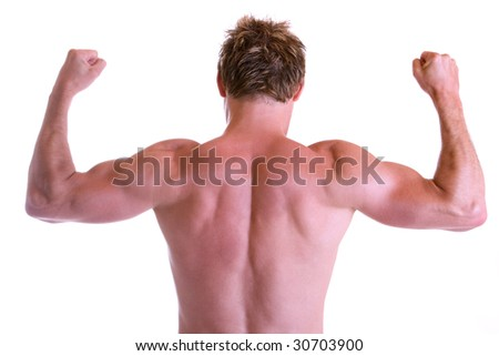 Man showing tighten his back muscles - stock photo