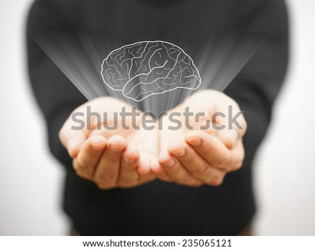 man showing virtual brains on open palm, idea concept - stock photo