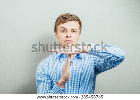 man shows a timeout - stock photo