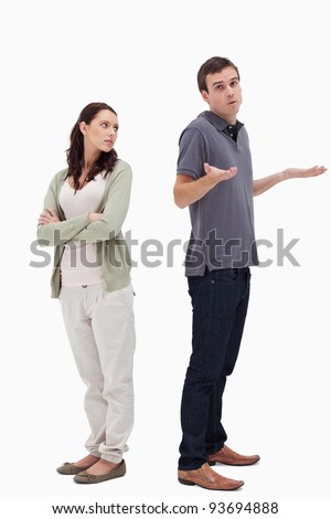 Man shrugged his shoulders back to back with angry woman against white background - stock photo