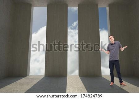 Man shrugging his shoulders against light shining into dark room - stock photo