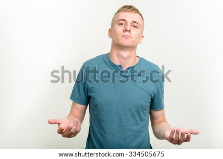 Man shrugging shoulders - stock photo