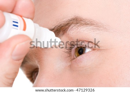 man sick with eye drops - stock photo