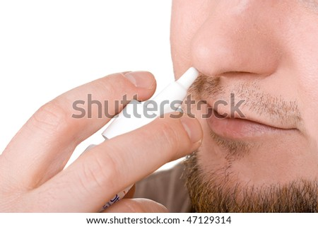 man sick with nasal drops