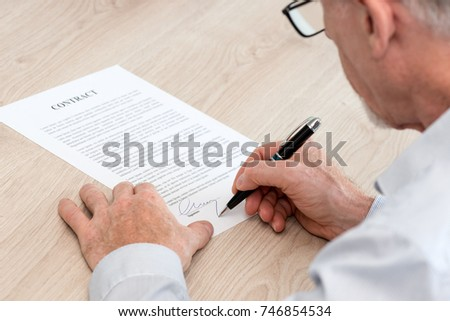 Man Signing Legal Document Stock Photo Royalty Free - Signing legal documents