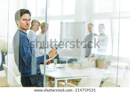 Man signing contract after business meeting in the office - stock photo