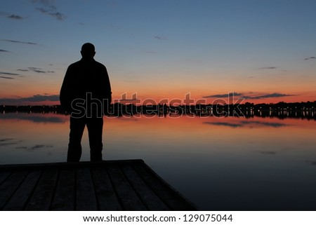 Man silhouette at sunset lake Palic, Subotica, Serbia