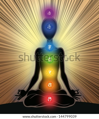 Man silhouette in yoga position with the symbols of seven chakras - stock photo