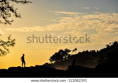 man silhouette on the sunset, Thailand