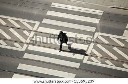 Man silhouette on zebra, pedestrian crossing. - stock photo