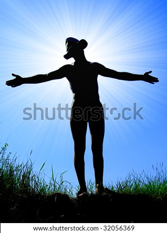 Man silhouette over sunlight - stock photo