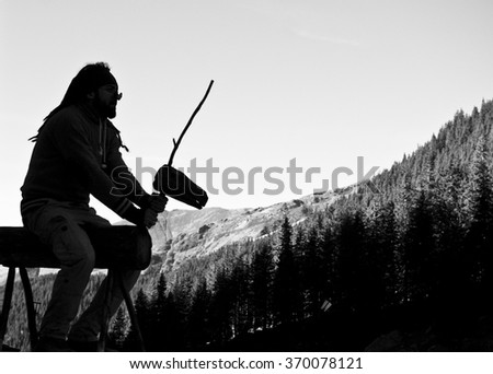 Man silhouette riding on a mountain  - stock photo