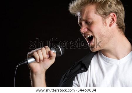 Man singer singing karaoke - stock photo
