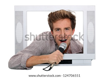 Man singing inside television - stock photo