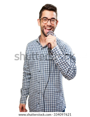 man singing with microphone - stock photo
