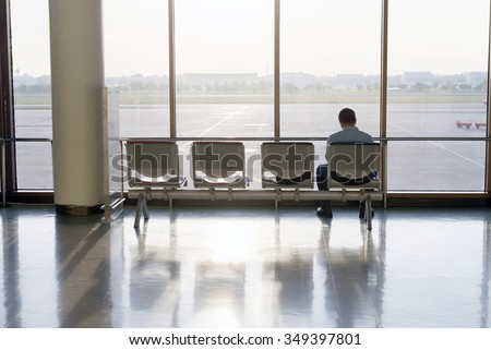 man sit in the airport - stock photo