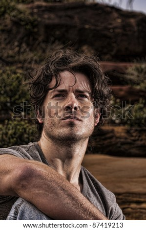 Man sits and contemplates his future - stock photo