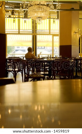 man sitting alone in a pub and reading the menu