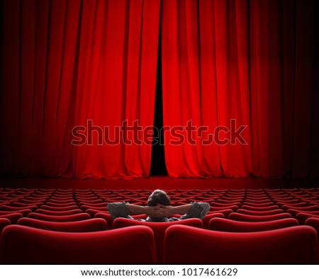 man sitting alone in VIP movie theater hall 3d illustration