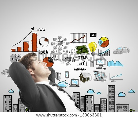 man sitting and thinking with drawing concept city - stock photo