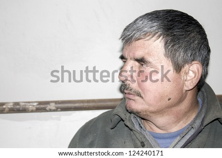 man sitting and watching me - stock photo