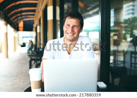 man sitting at cafe and drinking coffee - stock photo